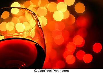 the night is young - close-up of wineglass with copyspace...