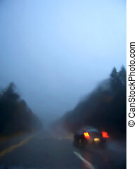 Driving in the Rain - A raining night on the road with bad...