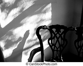 Antique Chair - Elaborate backed antique chair and shadow on...