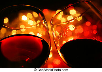 chin-chin - two wine glasses over backlighted background