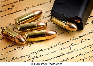 right to bear arms - bullets and modern loaded 9mm clip over...