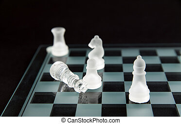 glass chess - checkmate - glass chess - dead king lying on...