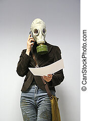 woman in a gas mask - The woman in a gas mask speaks by...
