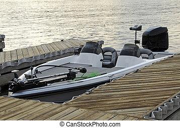 Bass Boat - A bass fishing boat at the lake boat dock