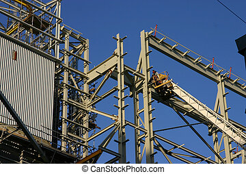 Iron workers - two iron workers work on a structure