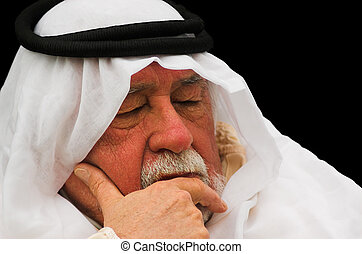 Napping - An older gentleman taking a nap, wearing Arabic...