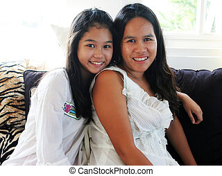 Happy Asian family - mother and teenaged daughter