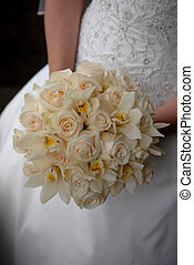 Bridal bouquet - Close up image of a bride holding a softly...