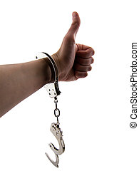 Breaking Free - Photo of a mans arm with one handcuff on and...