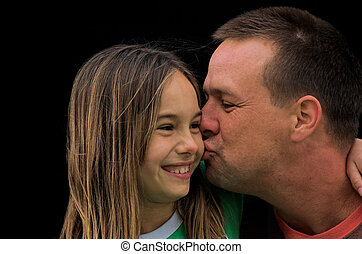 A Father\\\'s Kiss - A father kissing his daughter on the...