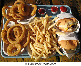 Tray of Junk Food - Cardboard tray of fries, onion rings,...