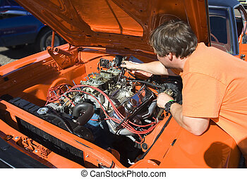 Tune up - mechanic tuning the carburetors on a classic...