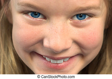 Young girl smiling - Close up of young girl with blond hair...