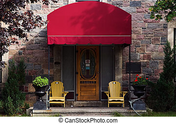 Doorway with red awning - Doorway with large red awning,...