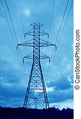 Blue Power - The silhouette of a power lines and towers...