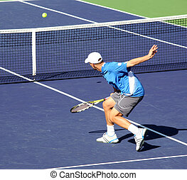 Tennis - Young man playing professional tennis