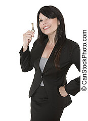 Key to - Smiling woman holding a key in her hand