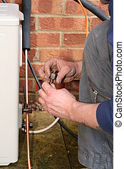 Air Conditioning - Engineer plumbing during an air...
