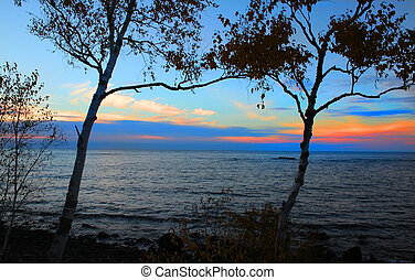 Colorful sky during sun set time along lake superior shore