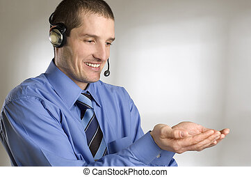 holding - young business men with headset holding hands...