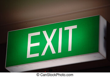 Exit sign glowing in a building