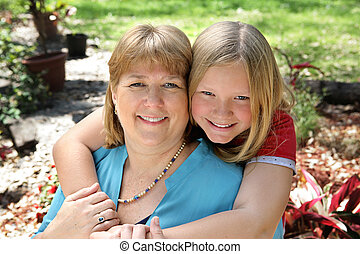 Mother & Daughter in Garden - Portrait of a pretty blond...