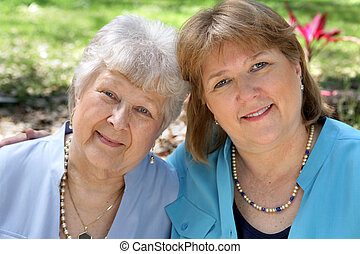 Adult Mother & Daughter - A grown woman and her senior...