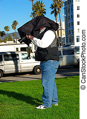 Undercover Paparazzi Photographer - A man photographer...