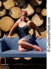 women on sofa - blond women on a blue sofa in the backround...