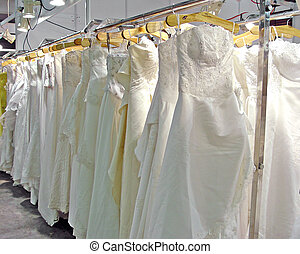 WEDDING DRESS - Many Wedding dress hanging in shop