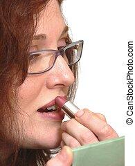Beautiful women 604 - An lady putting lipstick on her lips...