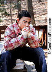 Pensive Teen Boy - Multi-cultural teen boy wearing casual...