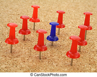 Stand out - Pushpin standing out from the crowd of other...