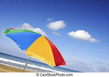 Bright Beach Parasol - Rainbow colored parasol at a jaunty...
