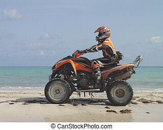 Atv on the beach in Haiti - A four wheels atv motorcycle on...