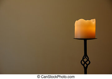 Romantic candle on a wrought iron stand