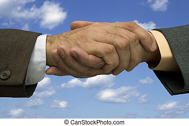 deal is done - handshaking on the sky background ,made form...