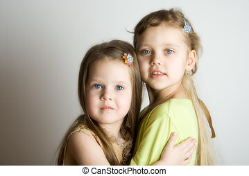 Sisters - portrait of the two little girl
