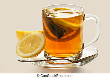 Hot tea with a lemon in transparent cup