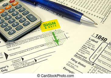 Tax Forms - Photo of Tax Forms and a Pen - Tax Related Items