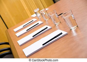 Getting ready - set boardroom with some water glasses and...