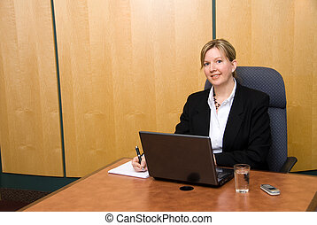 Working hard - Businesswoman in a board room with his grey...