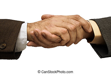 deal is done - Two businessmen shaking hands ,focus point on...