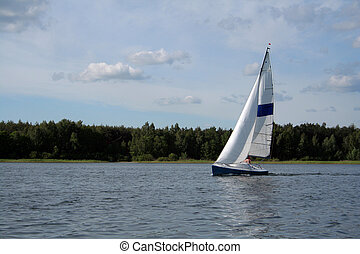 sail on the lake - boat on the lake near Powidz (Poland)