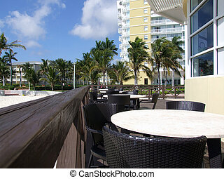 Beach Restaurant - tables and chairs outside of at a...