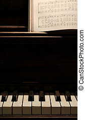 middle keys - old piano keyboard with hymn book above on...