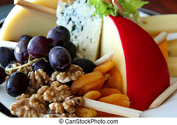 Fruit, Nuts, and Cheese - A fruit, nut, and cheese tray in a...