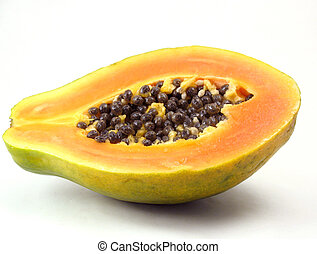 Papaya sliced in half on white - Green papaya with orange...