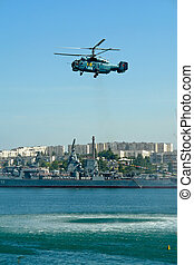 helicopter - The helicopter has hanged on a surface of water...