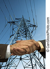 contract is done - handshake and electric line,special photo...